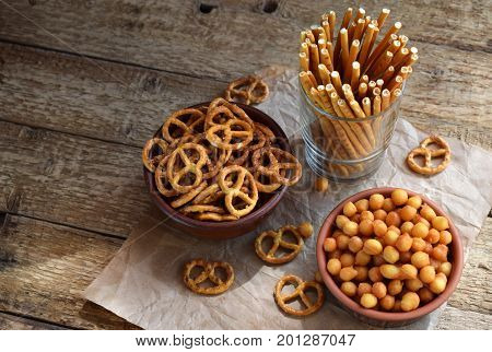 Salty Snacks. Crackers, Pretzel, Salted Straws, Nuts. Junk Food For Beer Or Cola. Photographed With