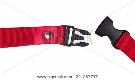 Side release buckle from plastic with Red belt nylon on the white background.