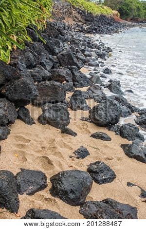 A view of rocks on the shoreline in the Kahana area of Maui Hawaii.