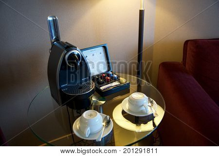 MAINZ, GERMANY - JUL 8th, 2017: Modern capsule coffee machine to make fresh espresso shot in a luxury hotel suite.