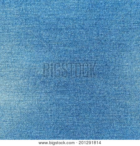 Denim texture. Light blue jeans. Fashion fabric