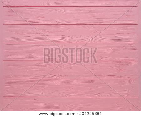 Pink painted wood board texture and background. Pink natural wooden background. Aged wood planks pattern. Wooden surface. Horizontal timber texture. Pink wood barn. Pink color wood barn. Wood board background. Pink wooden barn background. Painted wood.