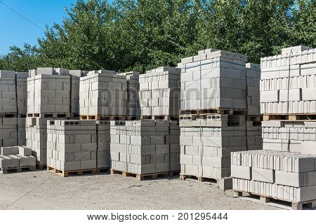 Concrete blocks on pallets in a building warehouse