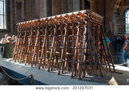 ST PETERSBURG RUSSIA - AUGUST 15 2017. Model of scaffolding designed by A. Betancourt and used for lifting cathedral columns. Interior of the St Isaac Cathedral in St Petersburg Russia
