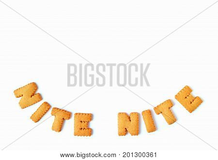 Top view of the word NITE NITE, made with alphabet shaped biscuits on white background, with free space for design and text