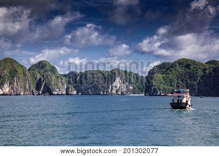 boats among beautiful limestone rocks of Lan Ha bay, the twin of Ha Long bay ona sunny day, Vietnam