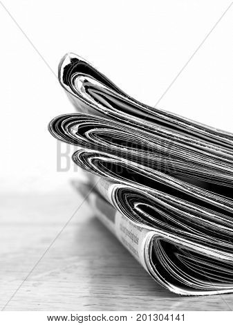 Stack of old newspapers for current events headlines