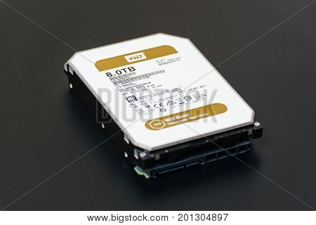PARIS FRANCE - JUL 28 2017: New WD Western Digital Hard data center hard drive wd gold series disk drive with 8 Terabytes capacity against black background. Western Digital is the biggest storage data manufacture worldwide