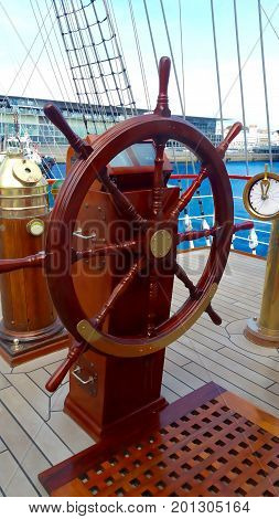 Ship's wheel on a tall classic sailboat