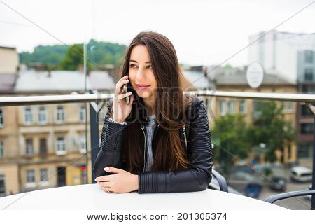 Portrait Of Beautiful Young Woman In Coffee Shop Terrace, Relaxing Using Smart Phone, Phone Call Con