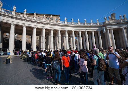 VATICAN CITY VATICAN - September 13 2016: Waitng tourists in queue who want to visit the St. Peter's Basilica (Basilica Papale di San Pietro in Vaticano)