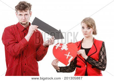 Divorce and separation concept. Couple have serious crisis in relationship. Husband and wife leave each other after argument. People with broken plaster heart.