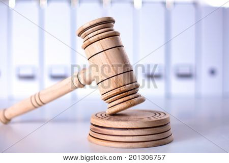A wooden judge gavel and soundboard isolated on white background in perspective.