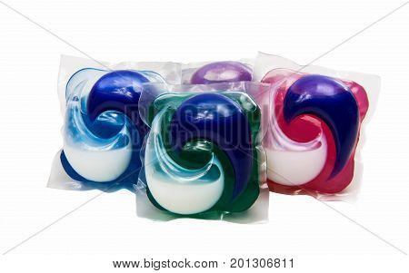 Pile of multiple washing pod capsules isolated over the white