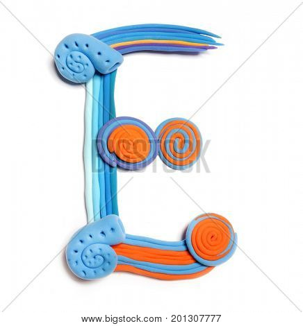 Plasticine letter E. Color plasticine alphabet, isolated. Blue and orange color of the alphabet