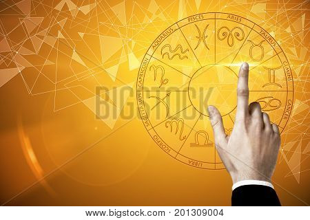 Businessman hand pressing abstract zodiac sign horoscope circle. Future concept