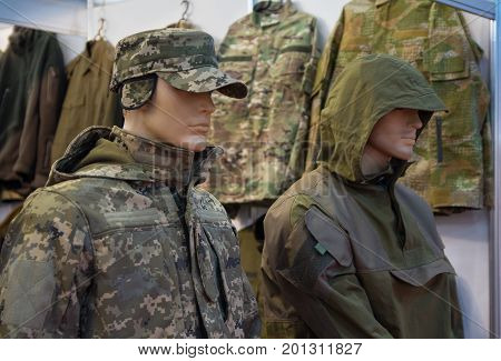 Mannequins in a camouflage military uniform in a store