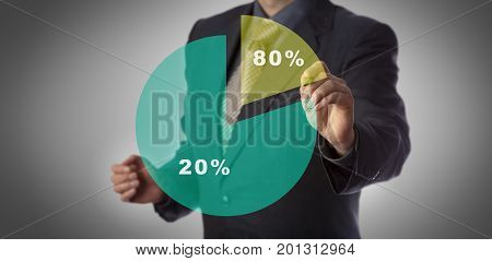 Unrecognizable manager with marker in hand approaching virtual pie chart illustrating the Pareto principle. Business concept for 80 - 20 rule law of the vital few and principle of factor sparsity.