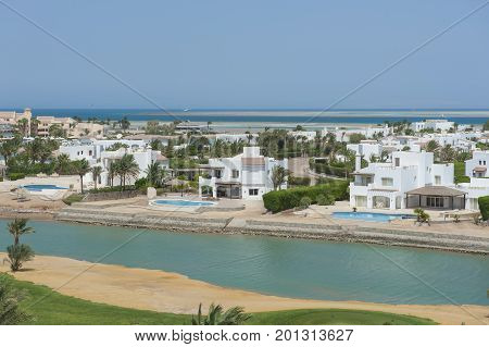 Aerial View Of Luxury Waterfront Holiday Villas On Coast