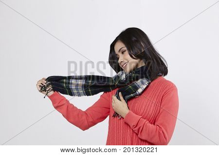 malay woman with checker scarf on the white background