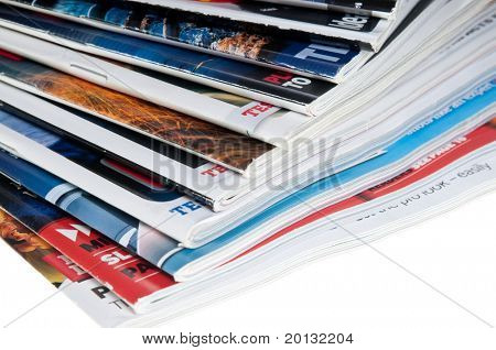Close-ups of stack of colorful  publications