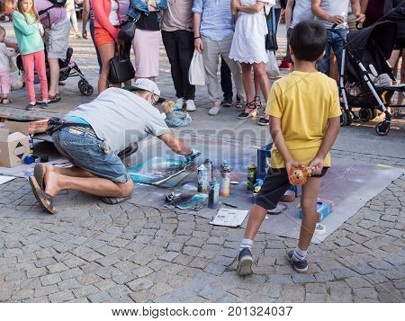 WROCLAW POLAND - AUGUST 14 2017: Street Painter Painting With Spray At Rynek Market Square In Wroclaw