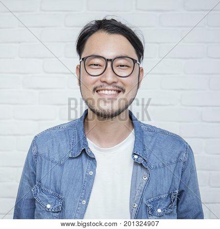 Attractive positive man - close up portrait asian nerdy man