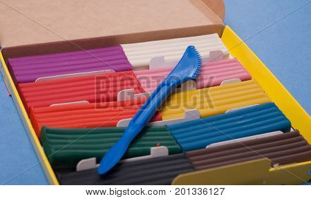 Set Of Colorful Plasticine, On A Blue Background.
