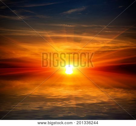 Sunset scene over water surface with reflection