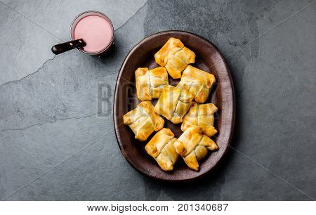 Mini Chilean Empanadas On Clay Plate With Typical Chilean Drink Vino Con Harina - Red Wine With Toas