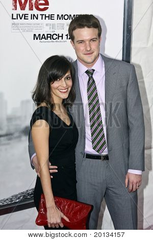 """NEW YORK - MARCH 1: Writer Will Fetters and his wife attend the movie premiere of """"Remember Me"""" at the Paris Theatre on March 1, 2010 in New York City."""