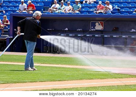 PORT ST. LUCIE, FLORIDA - MARCH 24: The head grounds keeper for the New York Mets waters the field during spring training on March 24, 2010 in Port St. Lucie, Fla.