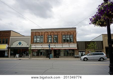 CADILLAC, MICHIGAN / UNITED STATES - MAY 31, 2017:  The historic Kramer Building houses Blossom Boutique, Intermission Healthy Skin Care, Wexford/Crawford Hospital Organization, and the Music Station.