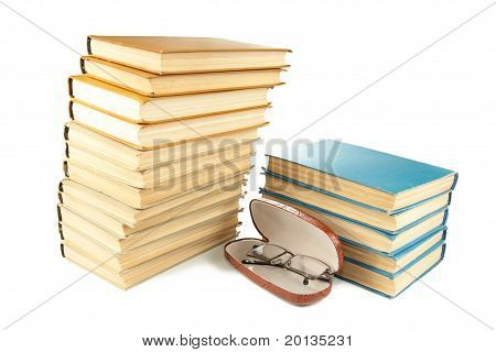 Pile Of Old Books And Glasses