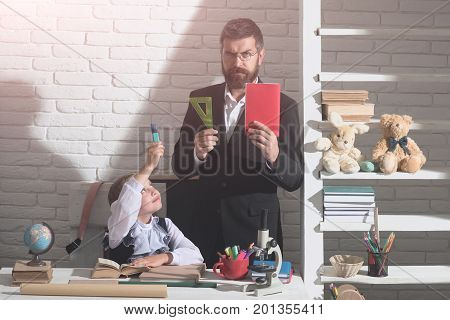 School And Home Education Concept. Girl And Father