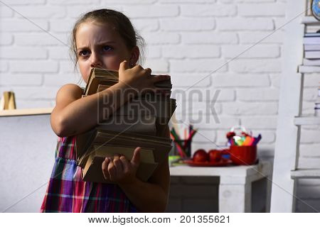 Girl Near Her Colorful School Stationery And Board