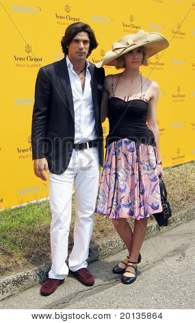 NEW YORK - JUNE 26: Argentine polo player Nacho Figueras and his wife attend the Veuve Clicquot Polo Classic at Governor's Island on June 26, 2010 in New York City.
