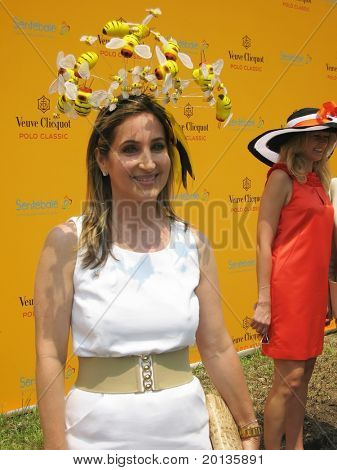 NEW YORK - JUNE 26: A guest arrives for  the Veuve Clicquot Polo Classic at Governor's Island on June 26, 2010 in New York City.