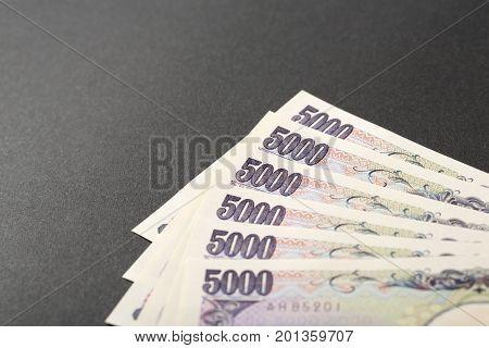 Japanese bank note 5000 yen on black background