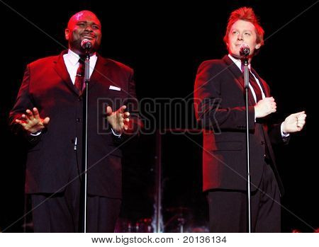 NEW YORK - AUGUST 11: American Idol singers Ruben Studdard (L) and Clay Aiken perform at the Hammerstein Ballroom during their Timeless Tour on August 11, 2010 in New York City.