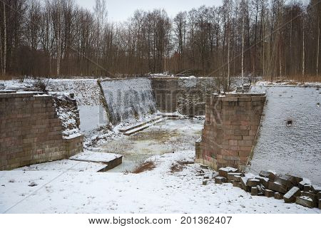 The ruins of the old Petrovsky dock in the gloomy January day. Kronstadt, Russia