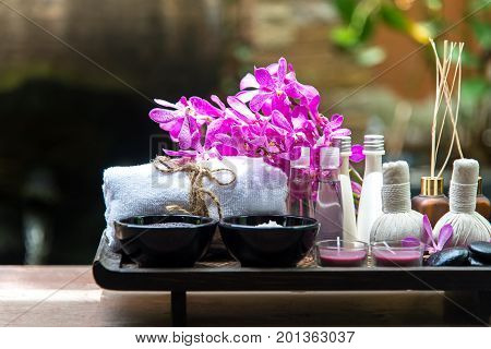 Thai Spa Treatments aroma therapy salt and sugar scup and rock massage with orchid flower. Healthy Concept. copy spaceselect and soft focus