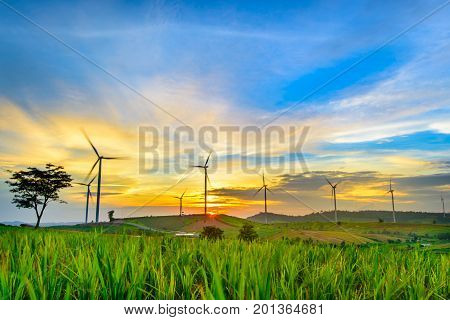 Wind generators turbines at sunset. Beautiful mountain landscape with wind generators turbines at Khao Kho mountain, Thailand. Renewable energy concept.