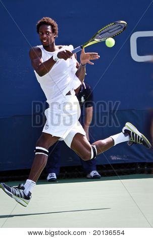 FLUSHING, NY - SEPTEMBER 2: Gael Monfils of France returns a volley during his men's doubles match at the US Open at the Billie Jean National Tennis Center on September 2, 2010 in Flushing, NY.