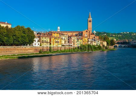 VERONA ITALY- September 08 2016: Morning scenery with Adige River Bell tower of Santa Anastasia's church and the embankment of Adige River.