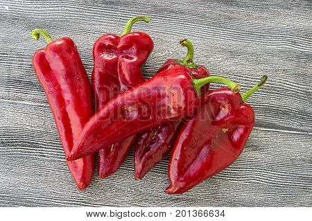 The most beautiful concept is Red fresh chilli on wood desk. the most wonderful Red hot pepper pictures for web and graphic design