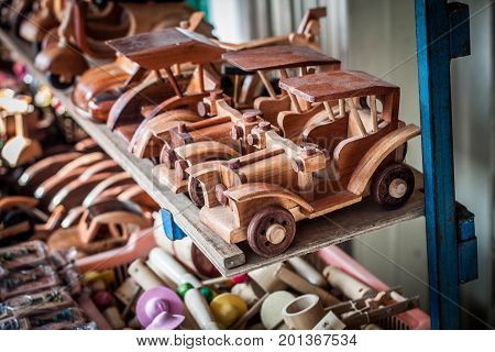 a traditional wooden car line on the store market java