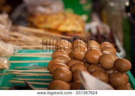 an egg sate angkringan street food brown color java