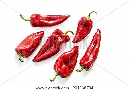 Red Hot Chili Peppers on white background   capia peppers in the plate To make sauce, sweet and hot peppers cape