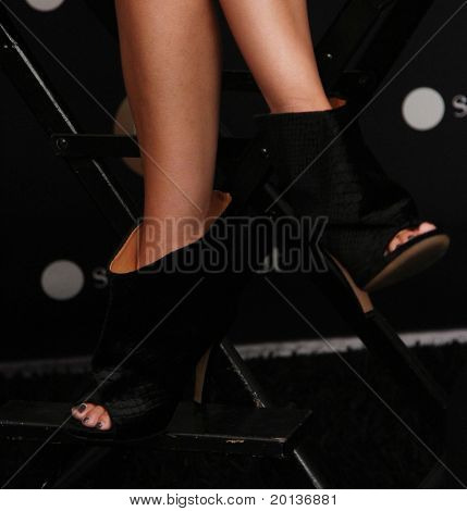 NEW YORK - SEPTEMBER 10: Actress Rachel Bilson black shoes that she wore at  the Sunglass Hut booth at Mercedes-Benz Fashion Week at Lincoln Center on September 10, 2010 in New York City.